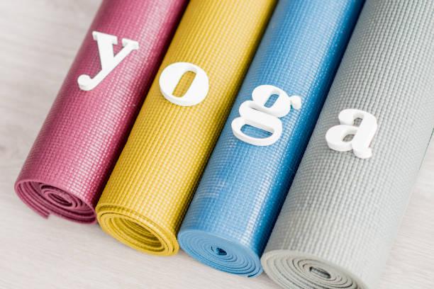 yoga spelled on mats - icon set healthy foto e immagini stock