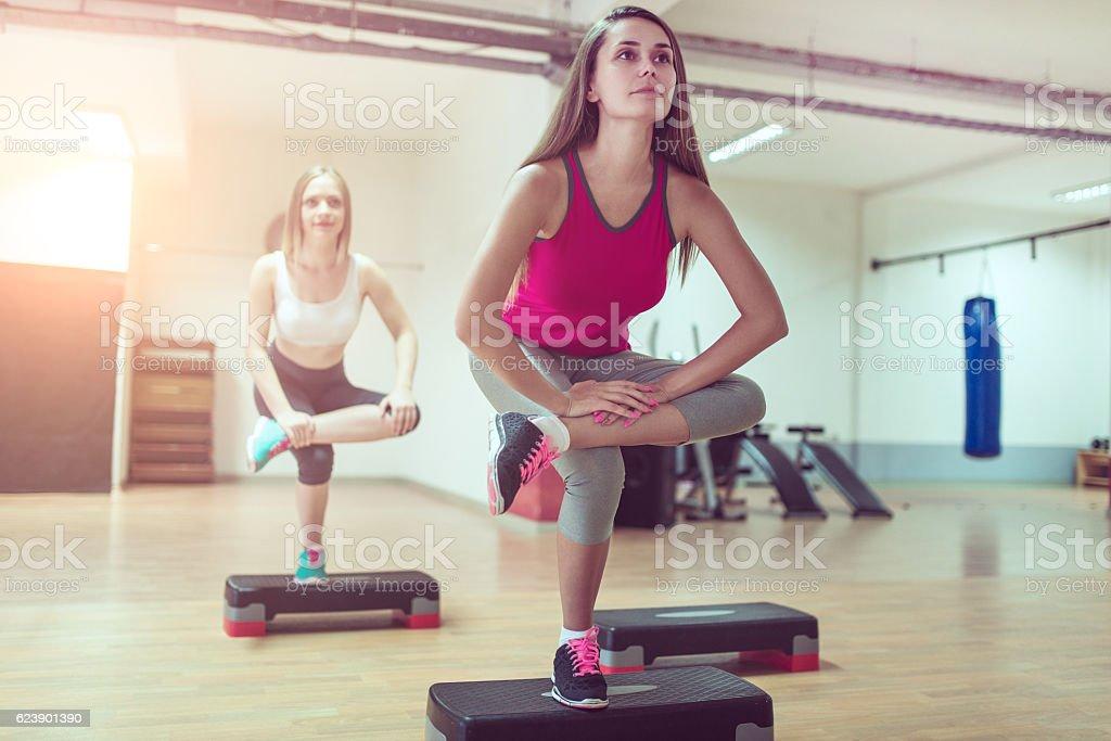Yoga Stretching on One Leg in Gym Before Aerobics Training stock photo