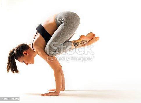 Female practices yoga, photo on isolated white background