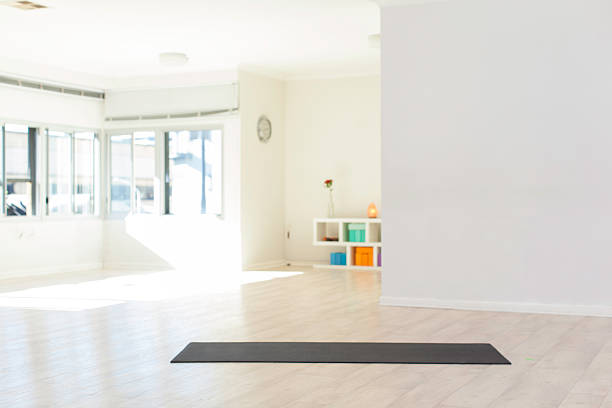 Yoga studio in Cape Town Indoors of a yoga studio with a yoga mat lying on the floor. Cape Town, Western Cape, South Africa yoga studio stock pictures, royalty-free photos & images