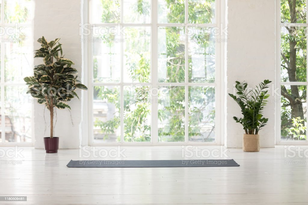 Yoga Studio Interior With Windows Plants And Unrolled Mat Stock Photo Download Image Now Istock