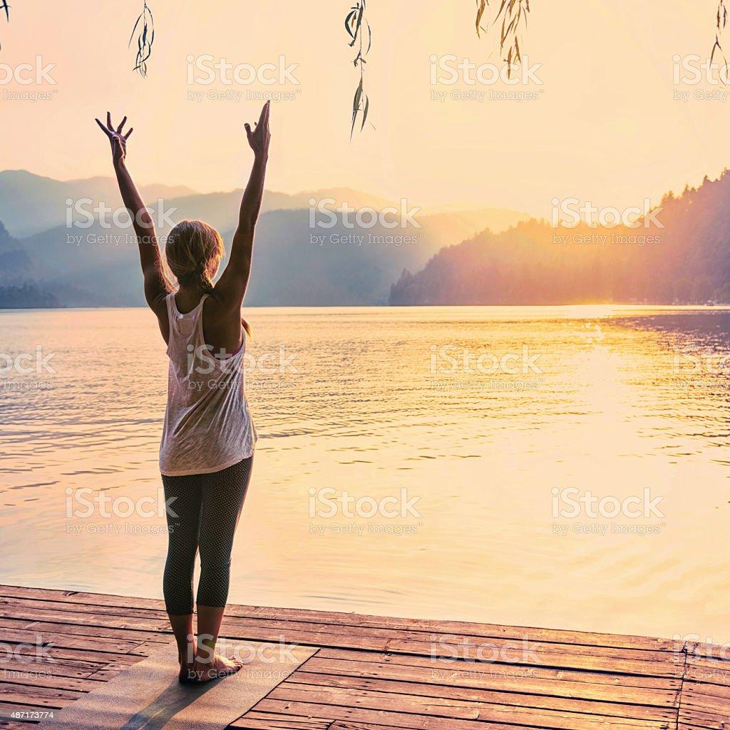 Yoga Sun Salutation stock photo