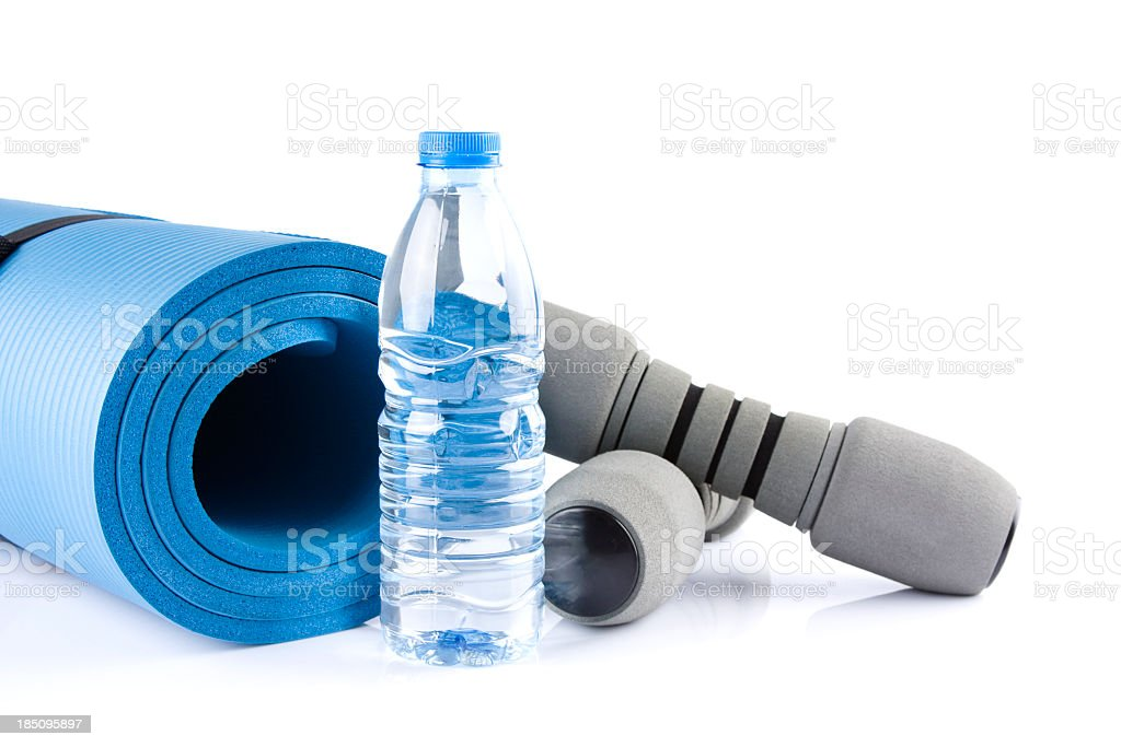 Yoga supplies - blue mat, water bottle and hand weights stock photo