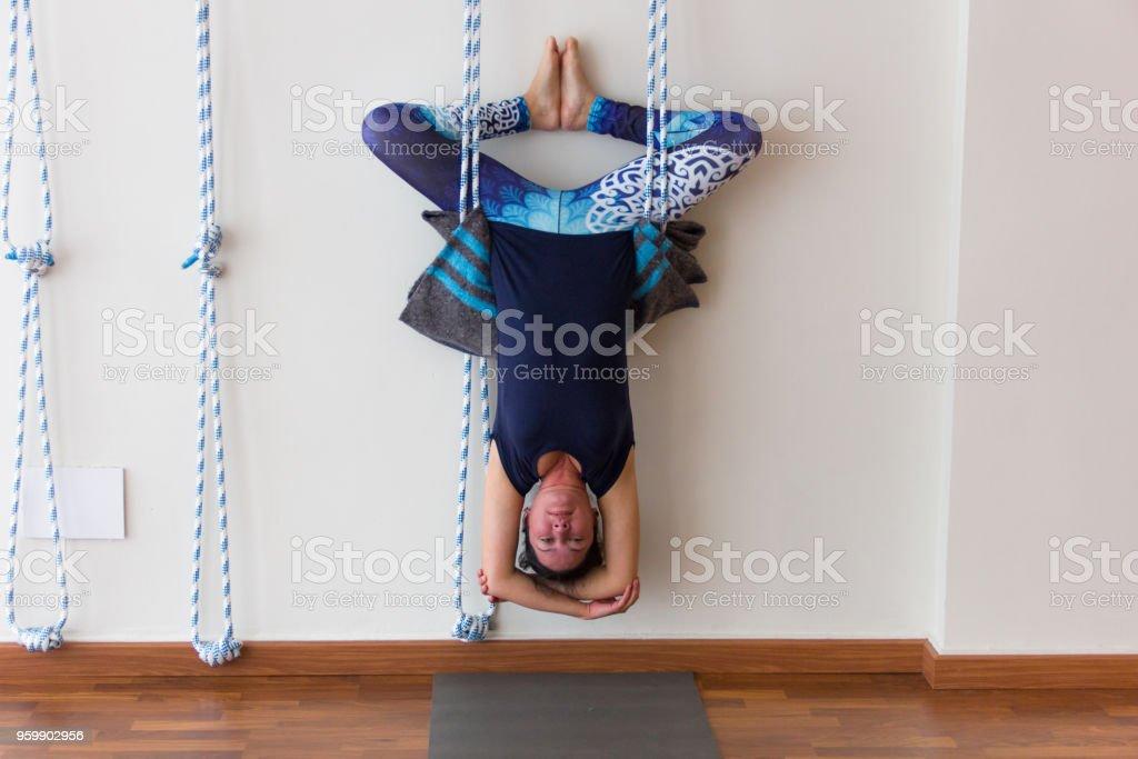 Yogi as bat like posture stretching whole body. Flexibility practice,...