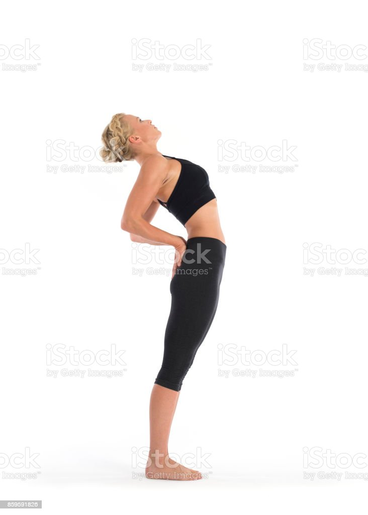 Yoga Teacher Performing Standing Backbend Pose Or Anuvittasana Asana In White Studio Stock Photo Download Image Now Istock