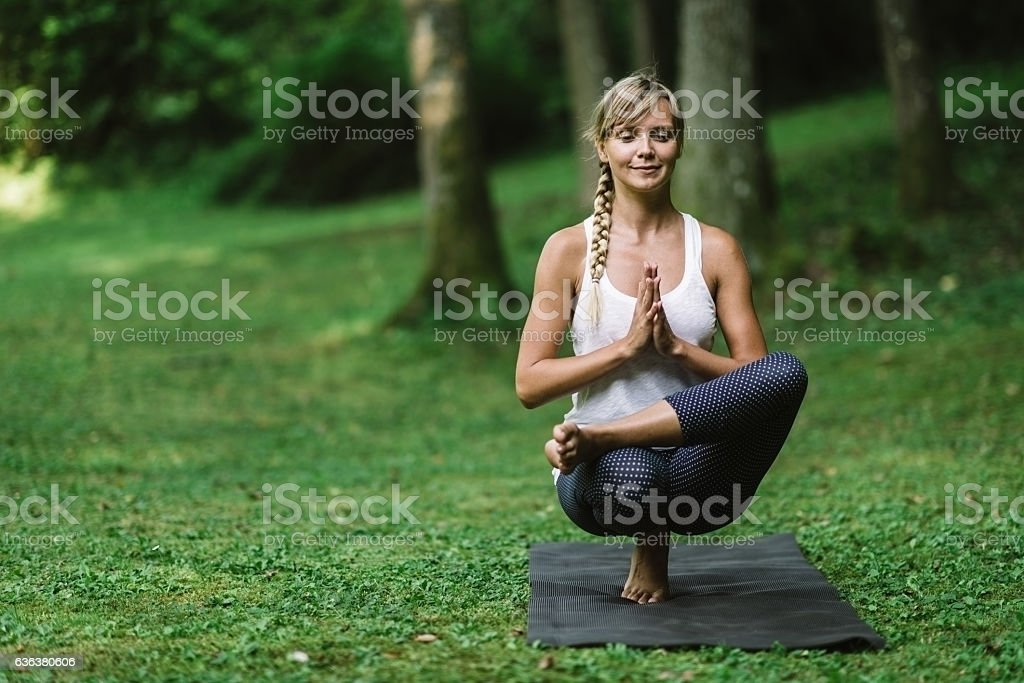 Yoga, Toe Standing stock photo