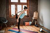 istock Yoga training in living room 1129449591