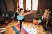istock Yoga Training in Living Room 1141210060