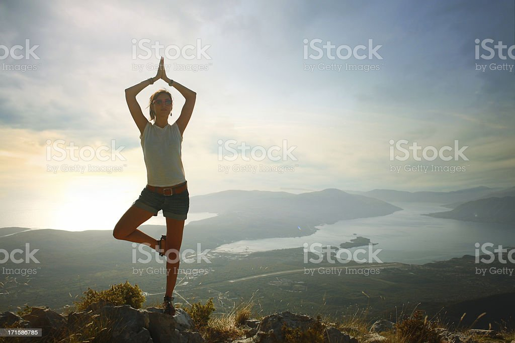 Yoga tree pose exercise royalty-free stock photo