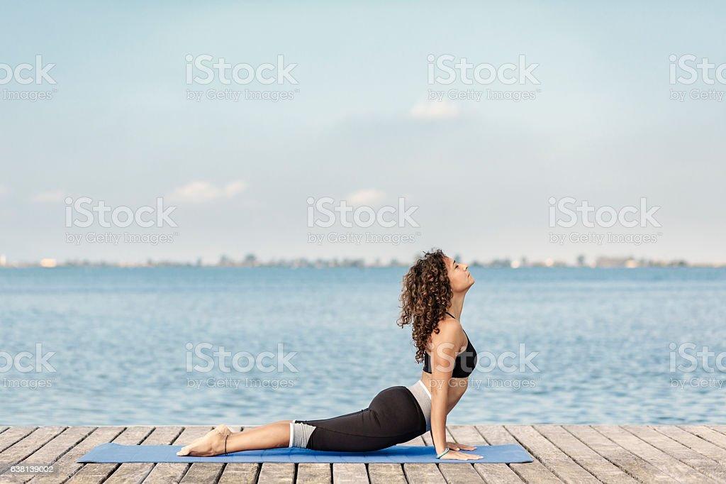 Yoga urdhvamukhasvanasana pose stock photo