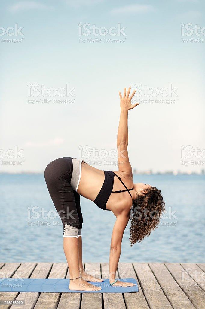 Yoga uttanasana twist stock photo