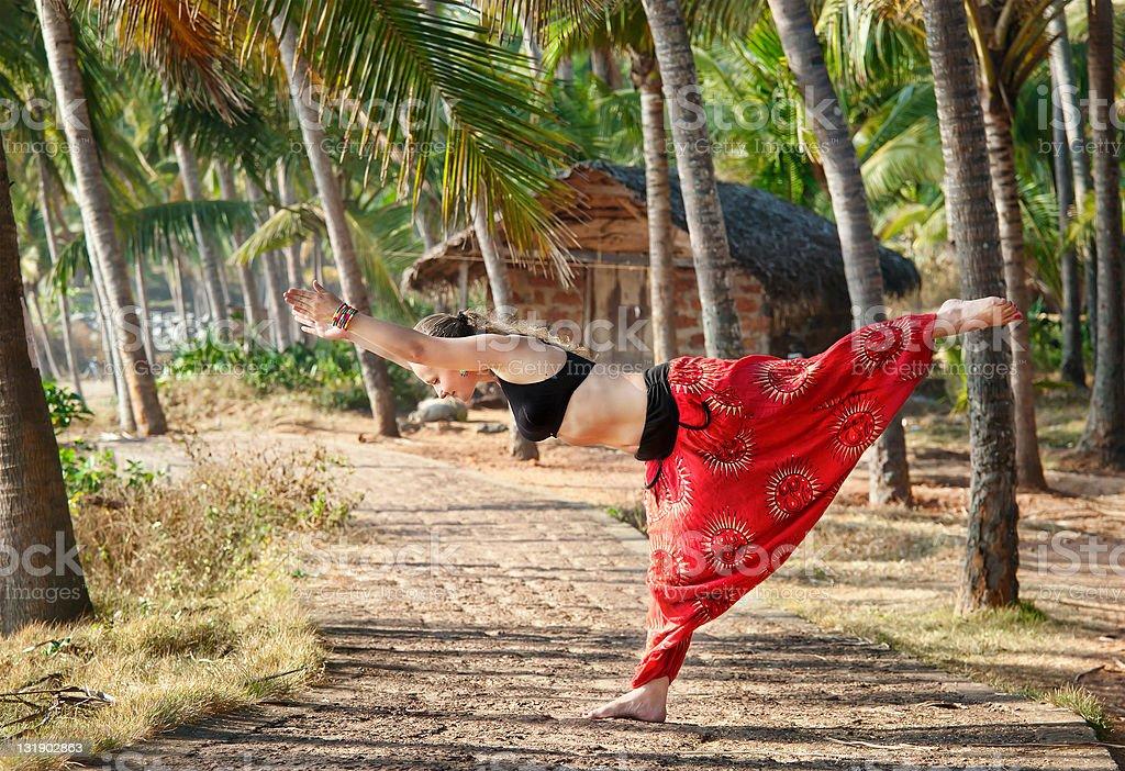 Yoga virabhadrasana III warrior pose stock photo