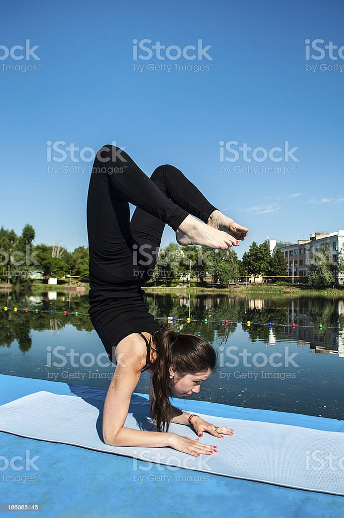 Yoga vrishchikasana pose royalty-free stock photo