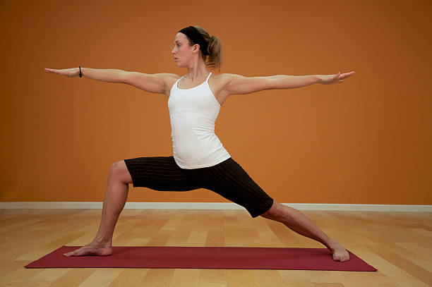 yoga warior 2 position with room for text stock photo
