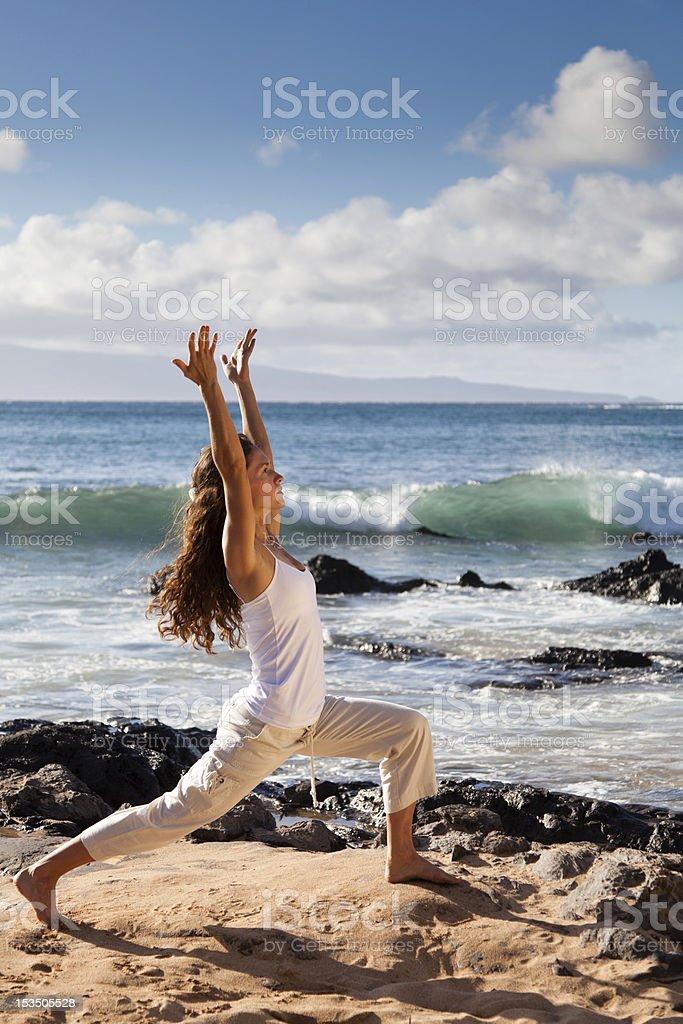 Yoga Warrior I Pose in Maui Hawaii stock photo
