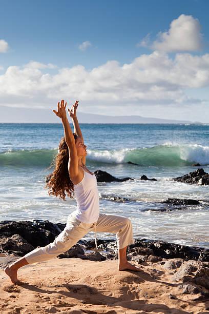 yoga warrior i pose in maui hawaii - carolinemaryan stock pictures, royalty-free photos & images
