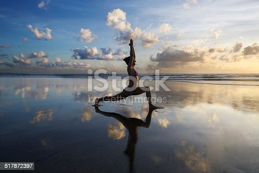 istock Yoga Woman at Sunset 517872397