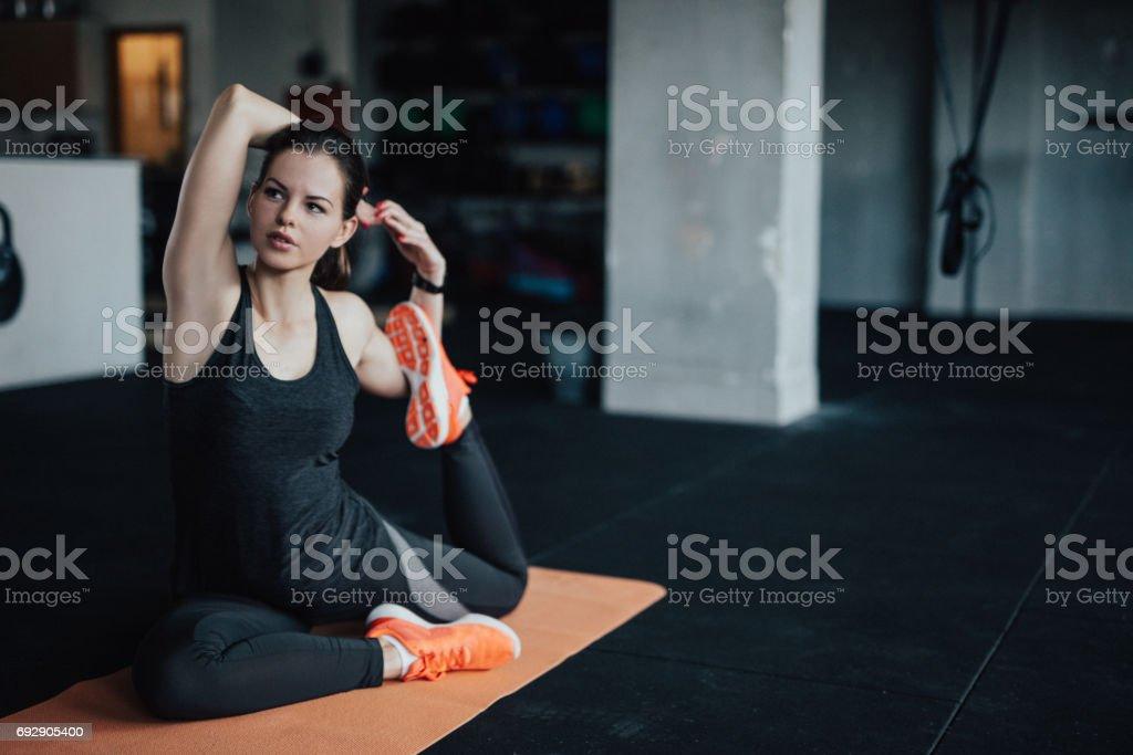 Yoga woman doing mermaid pose stock photo