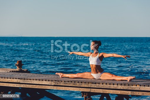 816941230 istock photo Yoga woman doing the splits 939590276