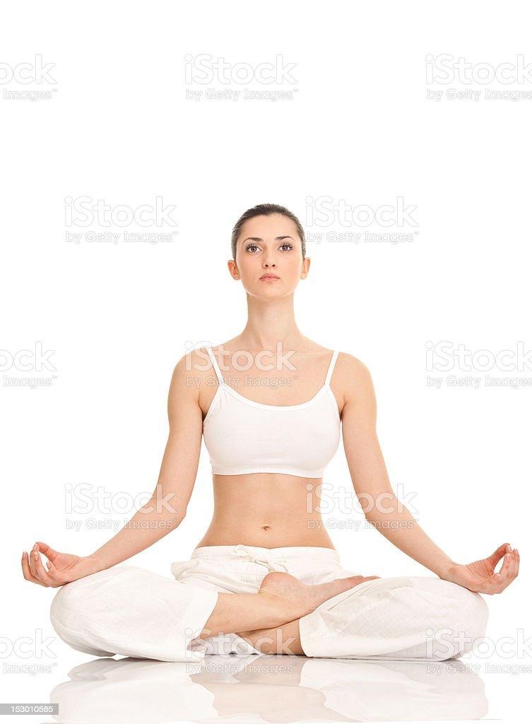 yoga, woman in lotus position stock photo