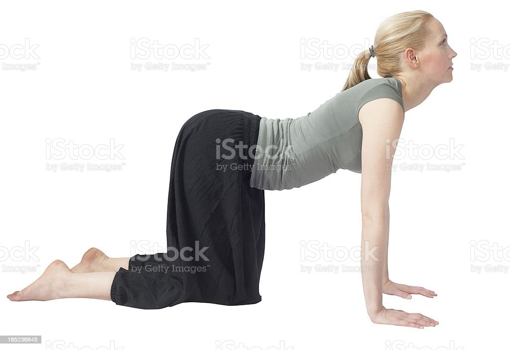 yoga woman isolated on white making the dog royalty-free stock photo