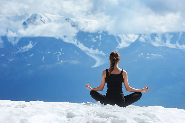 Yoga woman on the mountains background
