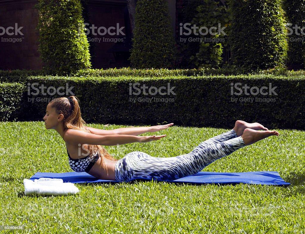 Yoga woman poses in tropics wearing stylish sportswear. Phuket island stock photo
