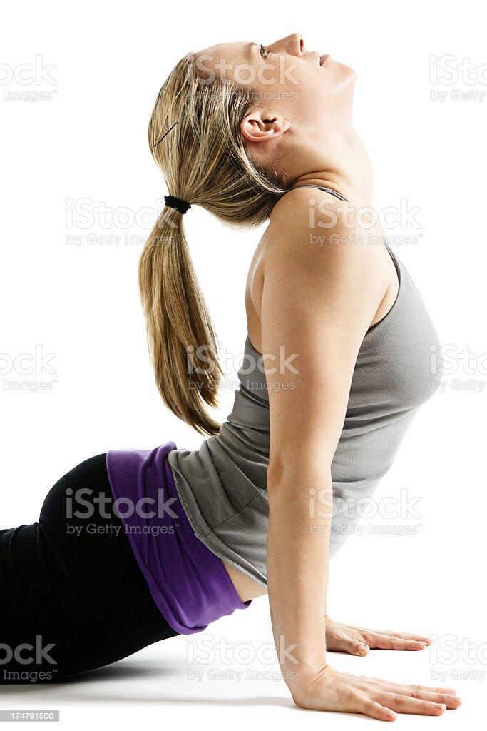 Yoga's Urdhva Mukha Svanasana or Upward Facing Dog being demonstrated royalty-free stock photo