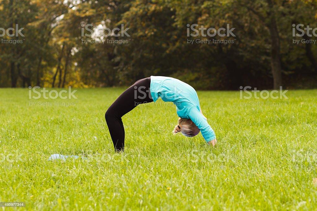 Yoga-Urdhva Dhanurasana/Upward bow pose stock photo