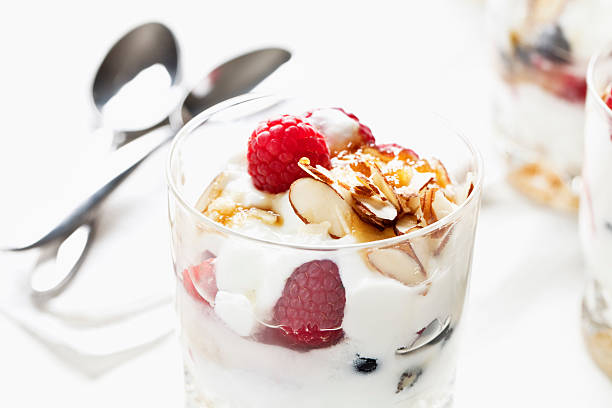 yoghurt and raspberries fresh dessert stock photo
