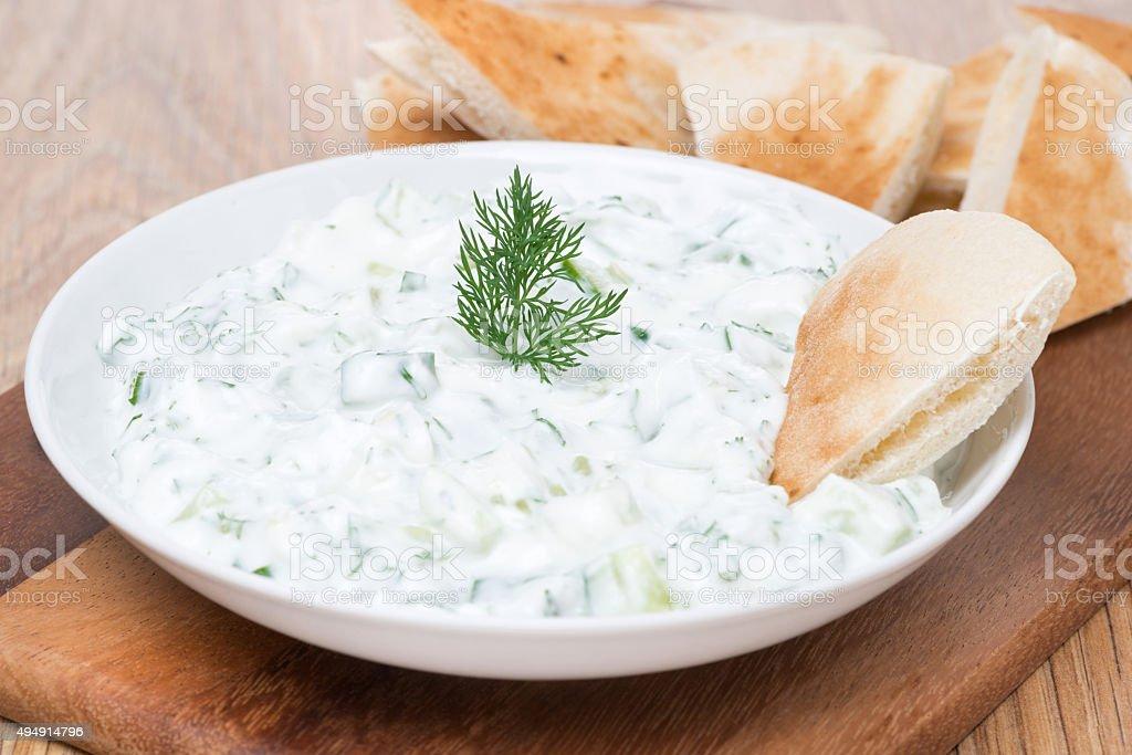 yoghurt sauce tzatziki with herbs, cucumber and garlic, close-up stock photo