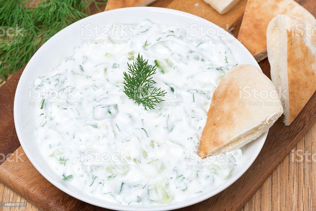 yoghurt sauce tzatziki with herbs, cucumber and garlic, top view stock photo