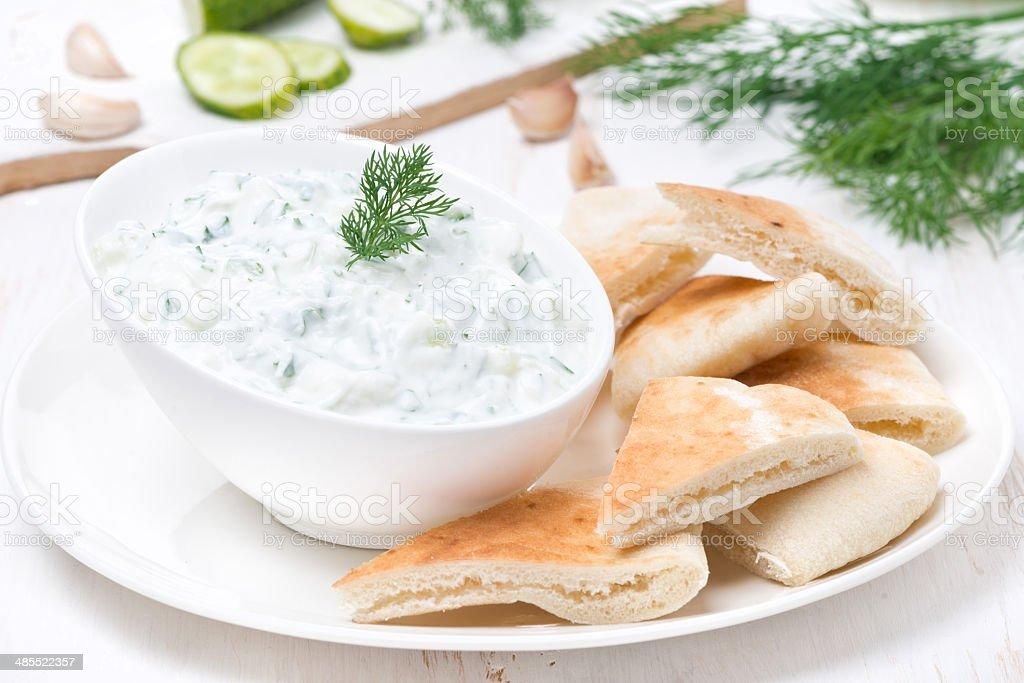 yoghurt sauce tzatziki with pieces of pita bread stock photo