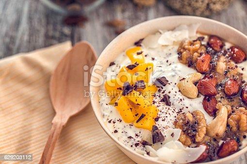 Yoghurt with juicy mango and honey cashew nuts, almonds, walnuts.