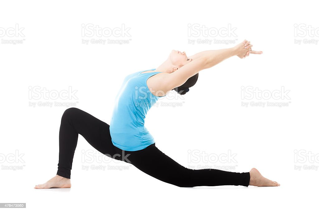 Yogi female in yoga asana Anjaneyasana stock photo
