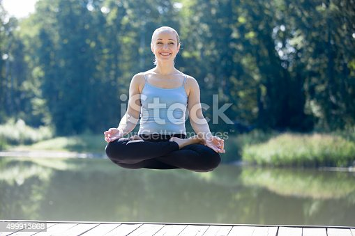 istock Yogi female meditating in thin air 499913668