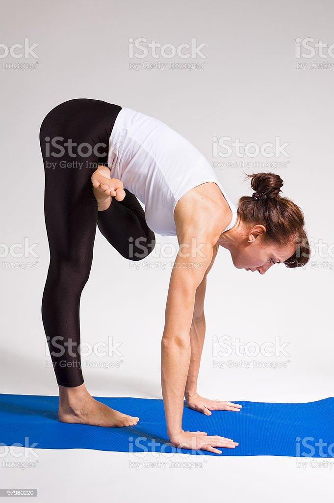 yogi girl doing exercise royalty-free stock photo