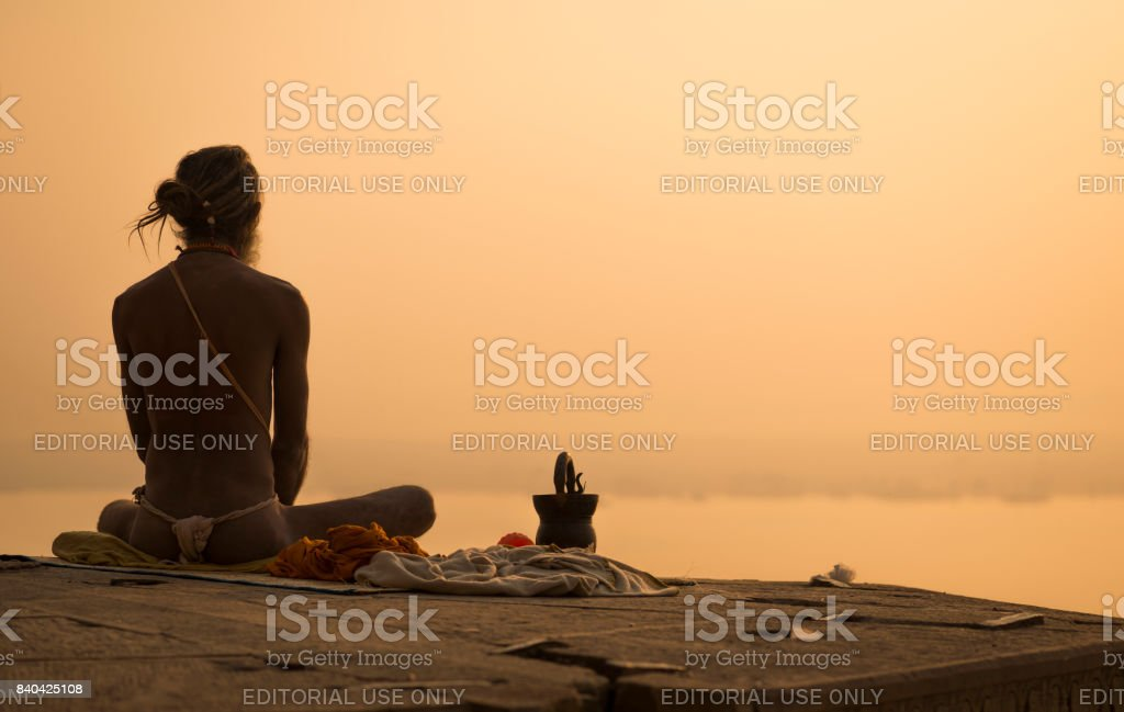 Yogi in India in the city of Varanasi, the embankment of the Ganges stock photo