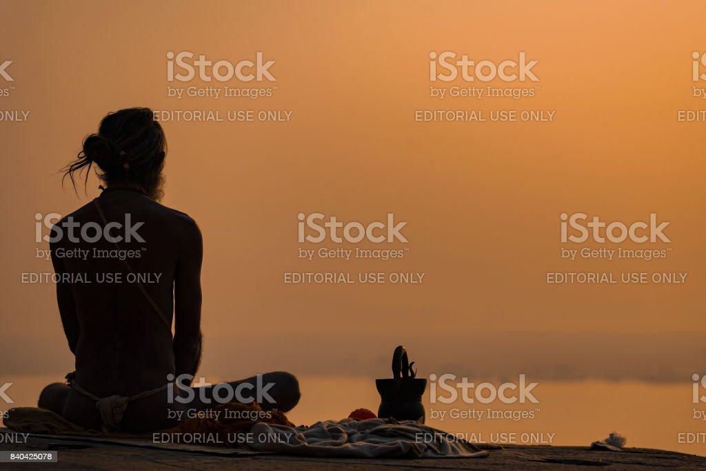 Yogi on the shore of the gang stock photo