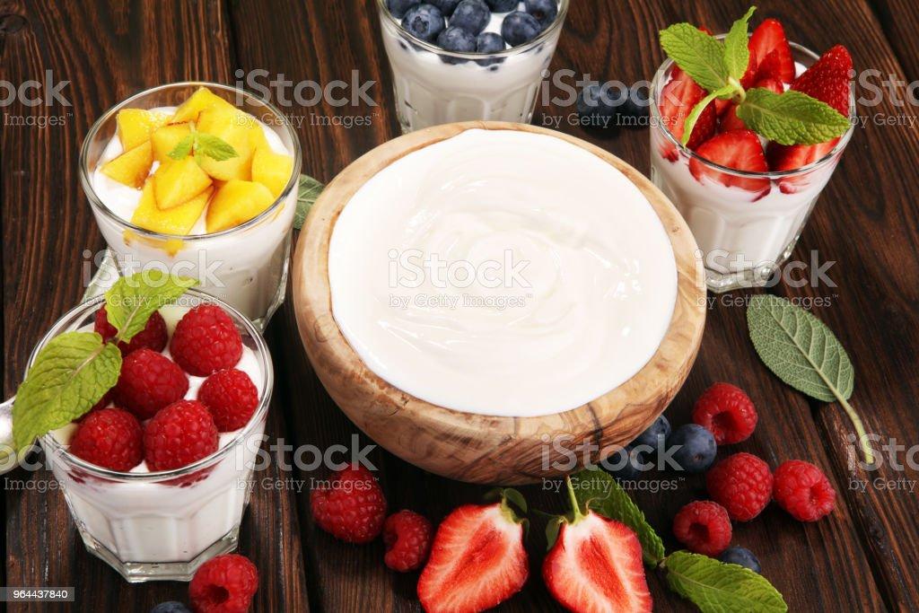 Yogurt and berry. Fresh fruit yogurt with fresh berries and peaches - Royalty-free Berry Stock Photo