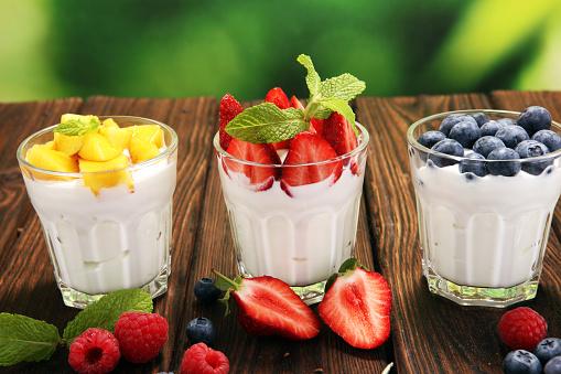 Yogurt And Berry Fresh Fruit Yogurt With Fresh Berries And Peaches Stock Photo - Download Image Now