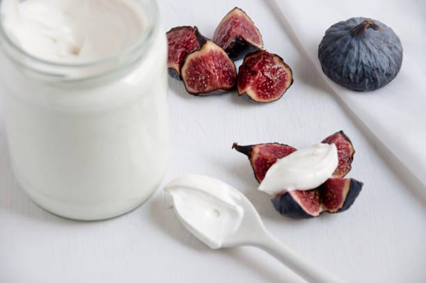 Yogurt and figs stock photo