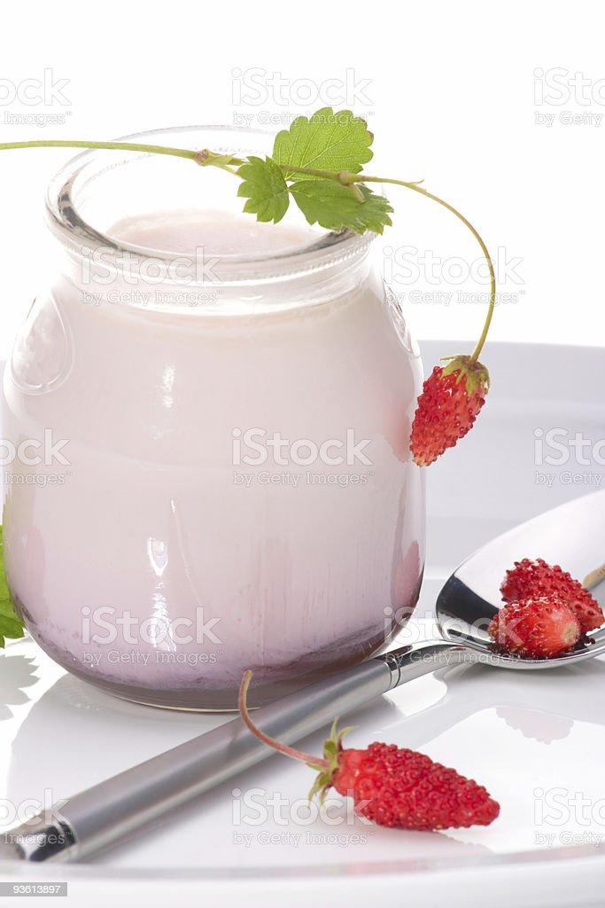 Yogurt and wild strawberries royalty-free stock photo