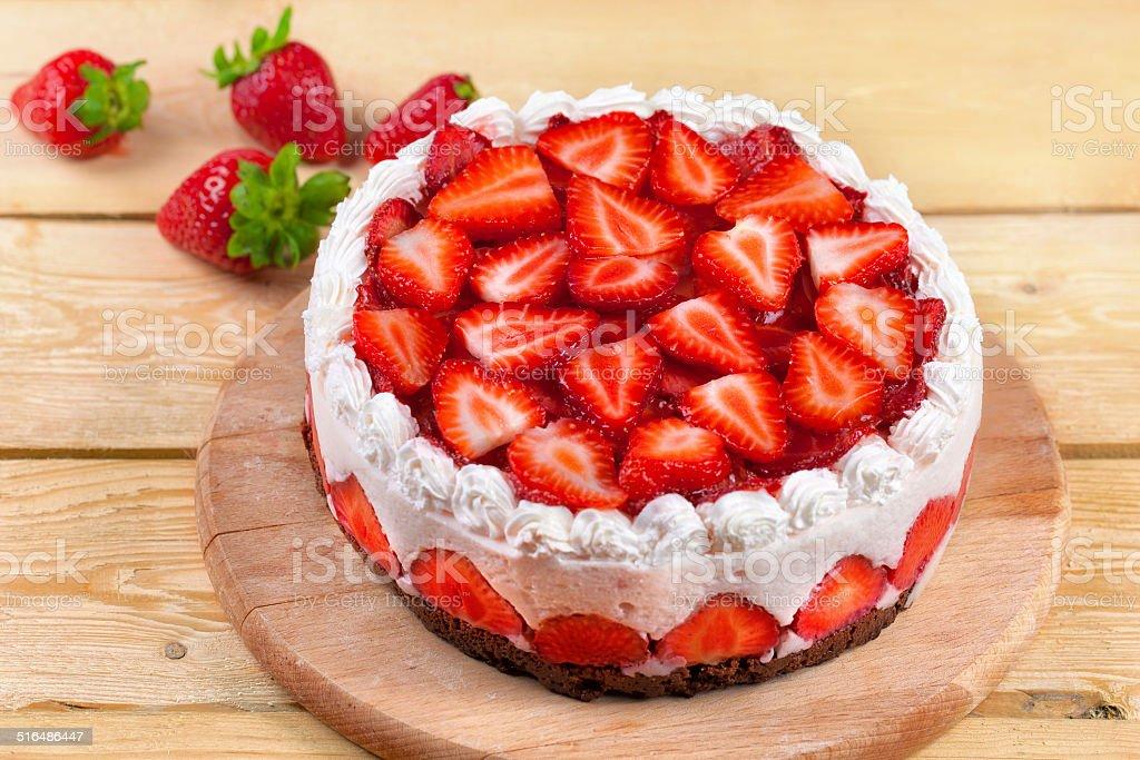 Yogurt cake with strawberries on wood table stock photo