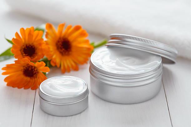 Yogurt cosmetic cream with calendula flowers vitamin spa lotion stock photo