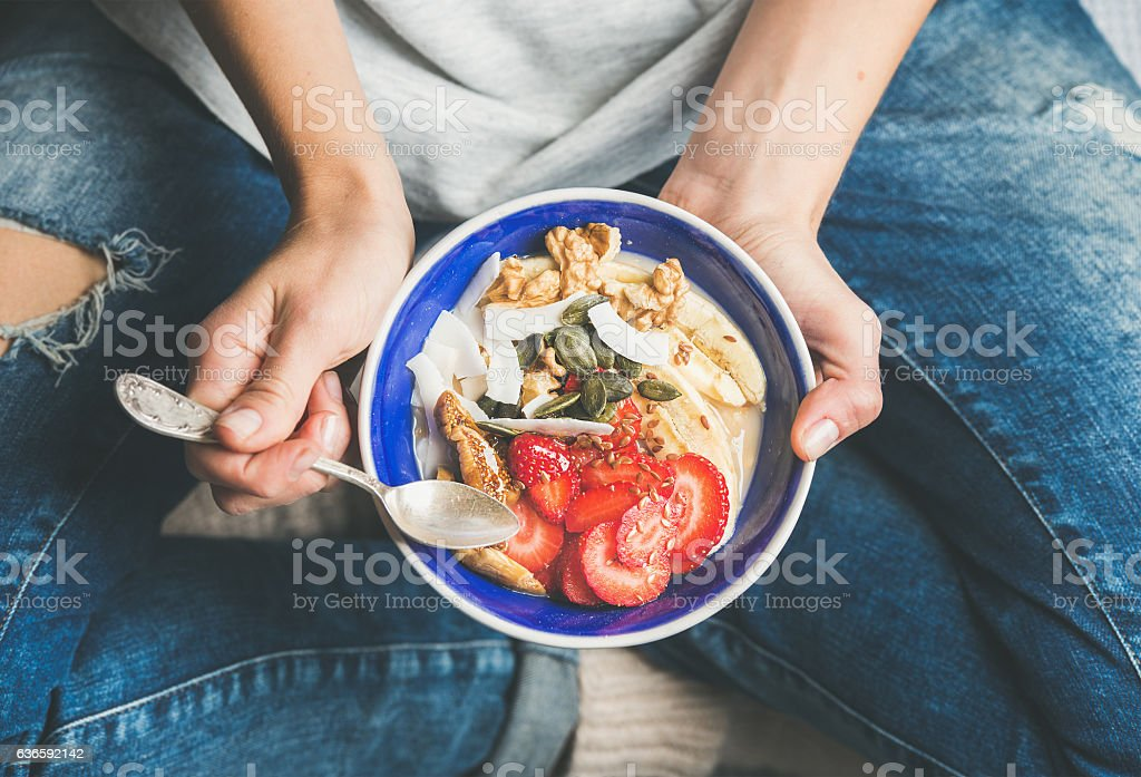 Yogurt, granola, seeds, fresh, dry fruits and honey in bowl stock photo