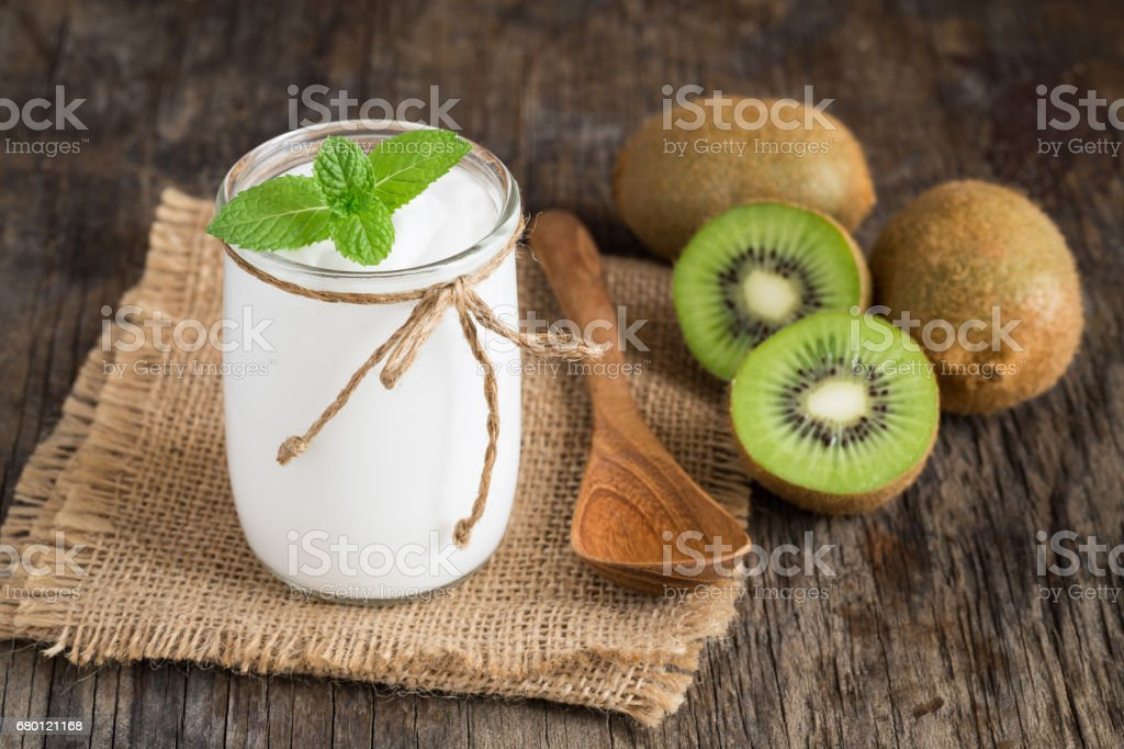 Yogurt in glass bottles on old wooden table stock photo