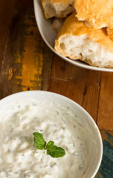 Yogurt, mint and lemon sauce with white bread stock photo
