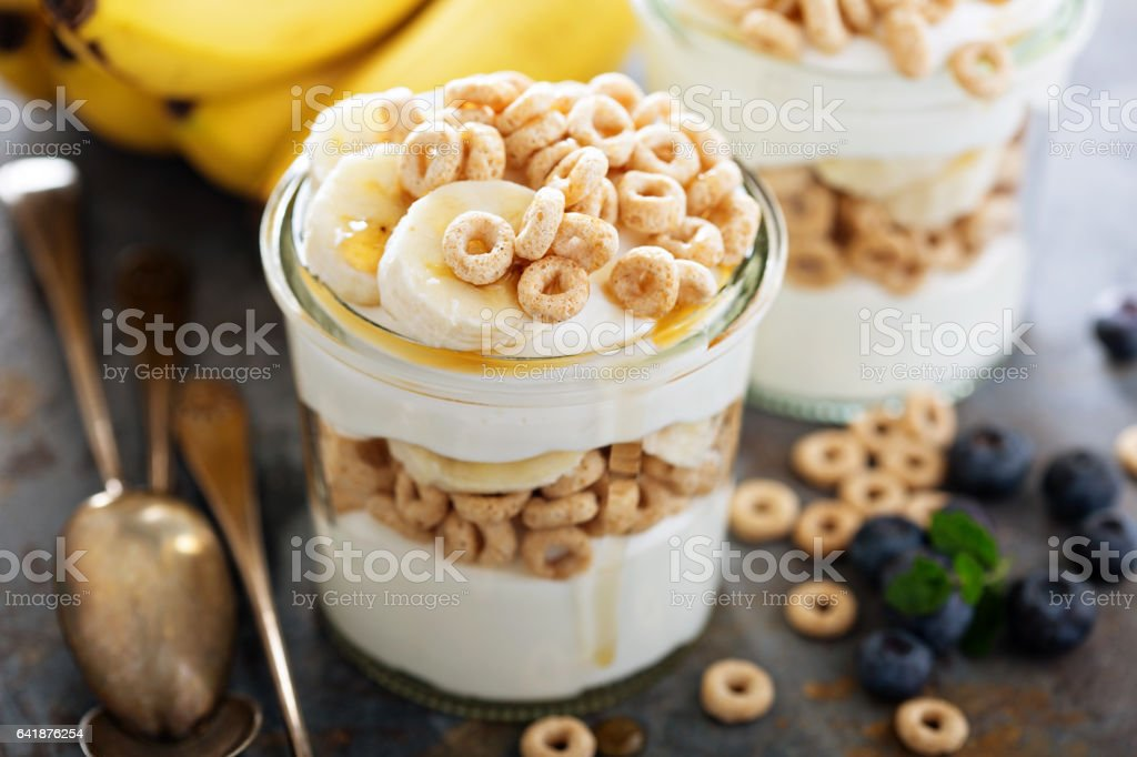 Yogurt parfait with cereal and banana stock photo