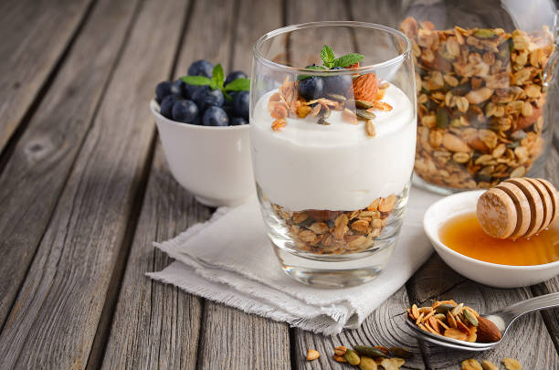 Yogurt parfait with granola and fresh berries, healthy breakfast concept. stock photo